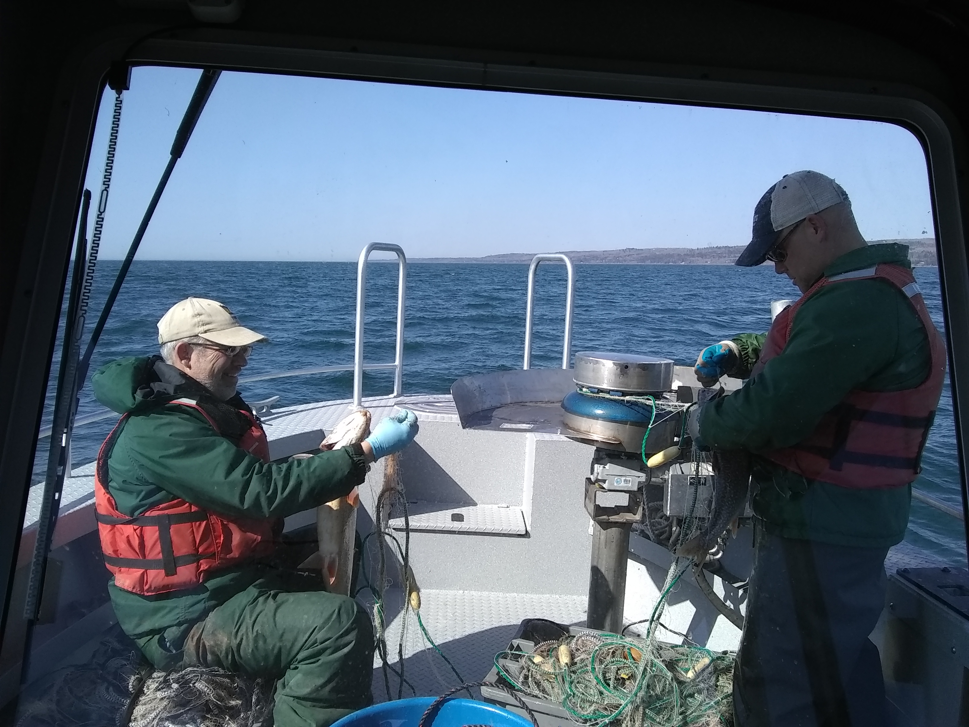 Cory Goldsworthy (right) urges that whilst the program has been a success, vigilance both with fishing quotas and lamprey treatment is necessary to maintain that success
